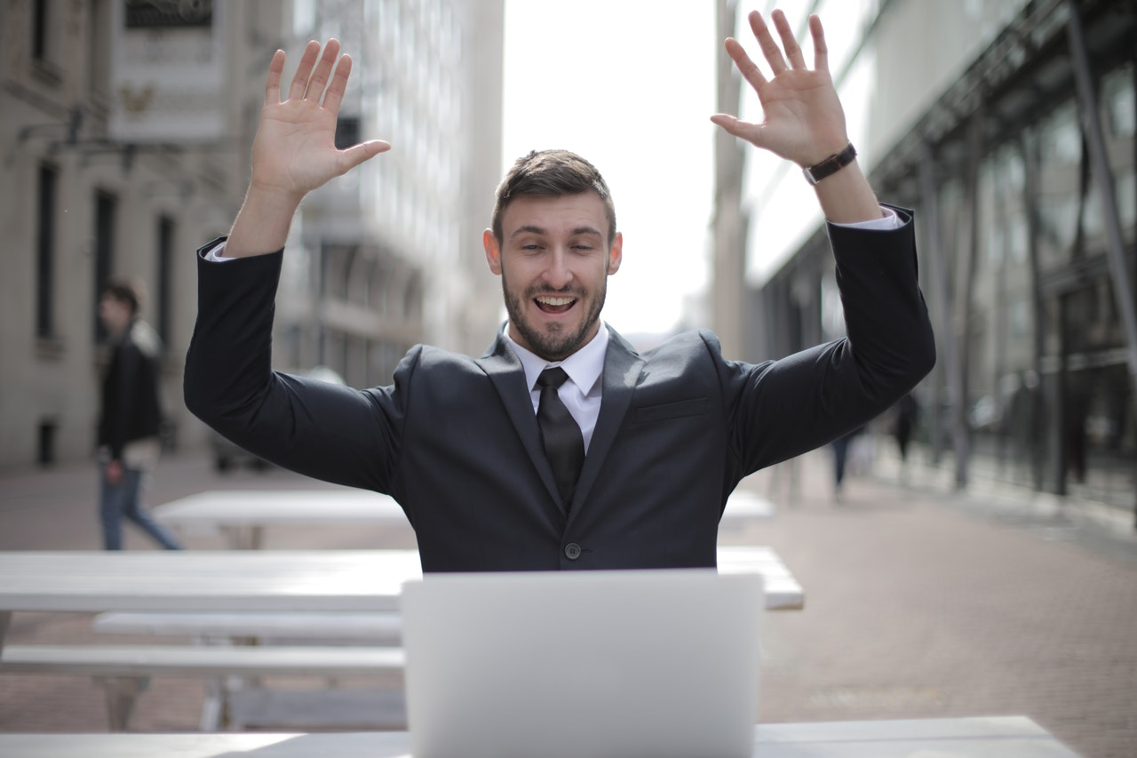 businessman hands in the air happy